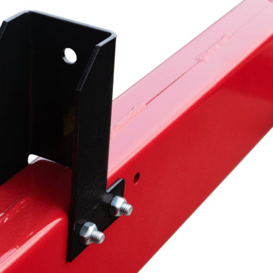 close up on mounting brackets on the hay wagon running gear