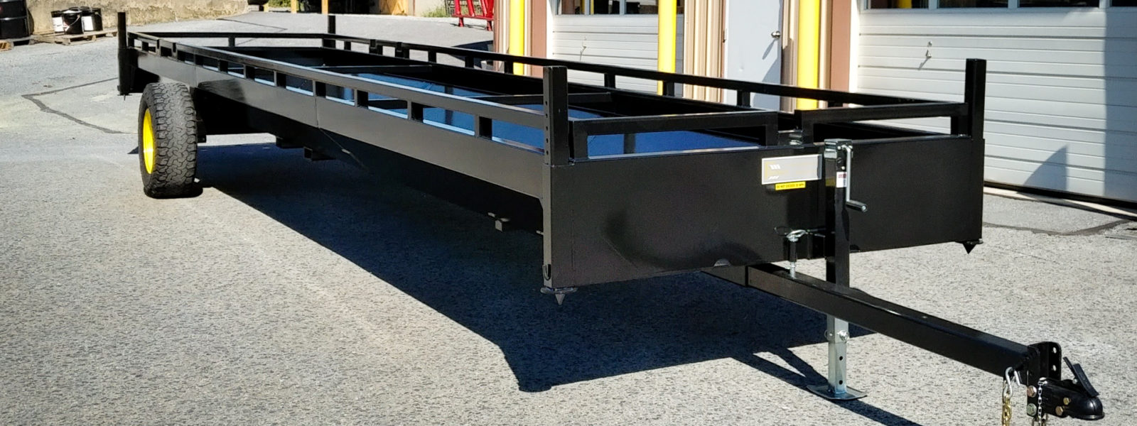 large black custom farm equipment trailer