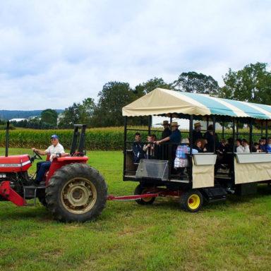 tractor pulling custom farm equipment trailer