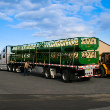 4 large custom hay feeders on trailer